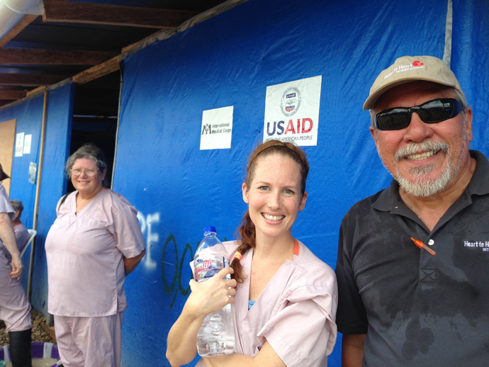 "(from left to right) Health care workers Catherine Thomas, Micaela Theisen, and Rene Vega—all working at USAID-supported ETUs—have taken the U.S. Ebola health care worker training course. ""The training was incredible and great for me because it alleviated my fears,"" said Theisen.  / Carol Han, USAID"