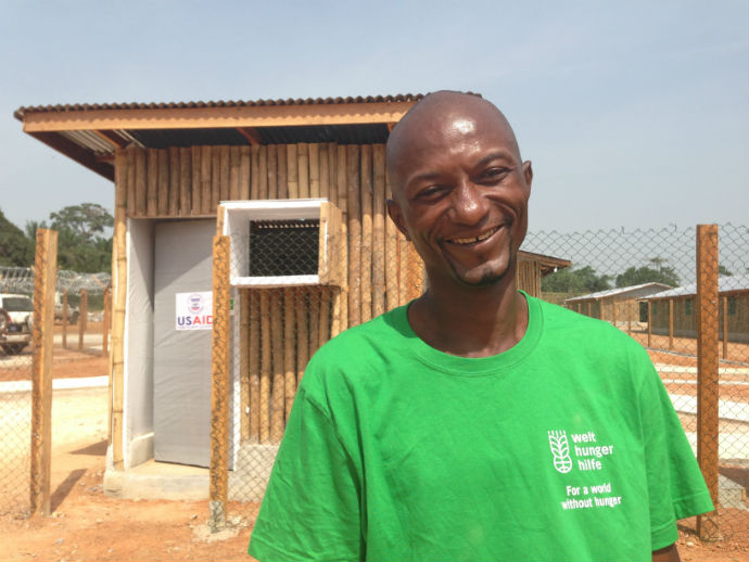 "Known as the ""mastermind,"" Daniel Dined is the head engineer who designed the Zwedru ETU and three others for USAID in southeastern Liberia. ""Working for the Liberian people, that's my primary goal and I love doing that,"" Dined said. / Carol Han, USAID"