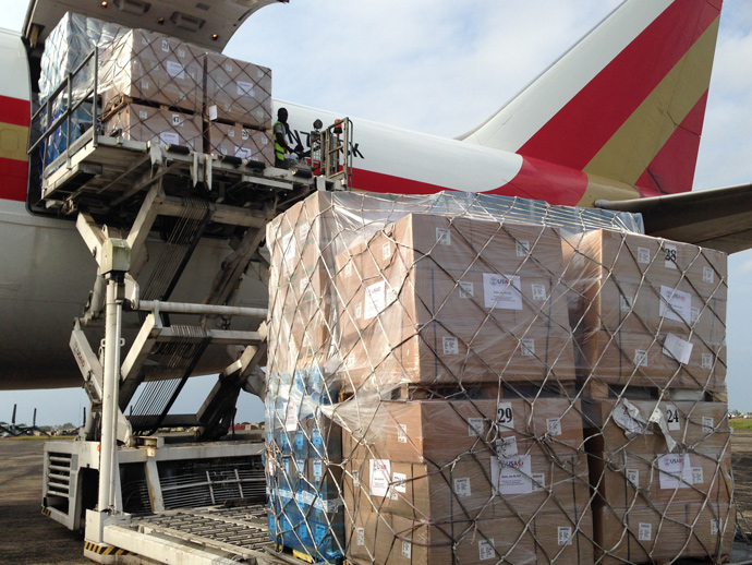 Inside the cargo hold, thousands of sets of protective equipment (PPE) to protect Ebola health care workers. As of January 2015, the U.S. has transported more than 400 metric tons of medical and disaster supplies to West Africa. / Carol Han, USAID/OFDA
