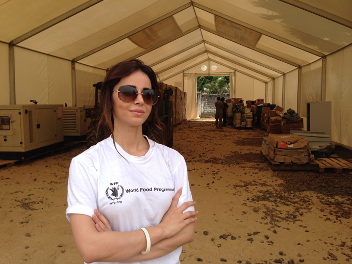 """It's a totally different crisis,"" said WFP logistician Mira Baddour at one of the warehouses in Liberia that her agency is running. ""It has been challenging, but at the same time it is a really great experience for me."" / Carol Han, USAID/OFDA"