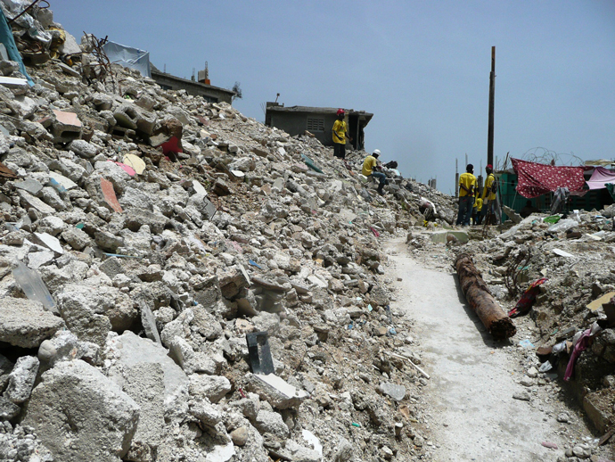 USAID-supported programs helped remove more than 50% of the total rubble cleared by the international community. / U.S. Navy, Chief Mass Communication Specialist Robert J. Fluegel