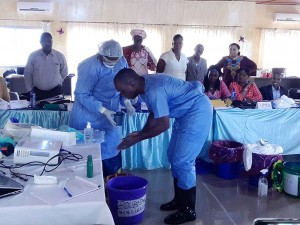 Participants in an infection prevention and control training in Guinea learn key skills. / Jhpiego