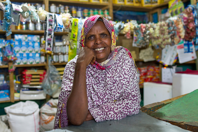 USAID's resilience programs in the Sahel are helping pastoralists to diversify their livelihoods so that they are not solely reliant on the land and are better prepared to cope with dry seasons. Sahra Osman Ibrahim received a loan to open up a shop through the USAID-supported Somali Microfinance Share Company. / USAID Ethiopia.