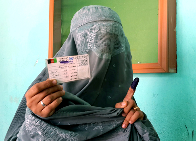 Female participation in the 2014 Afghan elections was unprecedented in scale, with women voters accounting for 38 percent of total turnout according to government counts. / USAID/Afghanistan