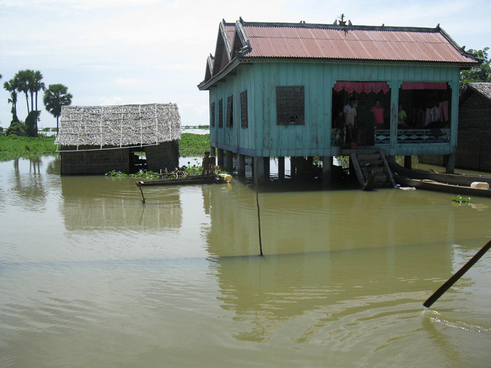 Heavy rains fell over nearly all of Cambodia in the fall of 2011. Floodwaters spread across 18 of 24 provinces, affecting 1.5 million people, and destroying nearly 10 percent of the nation's crops. / Brian Heidel, USAID