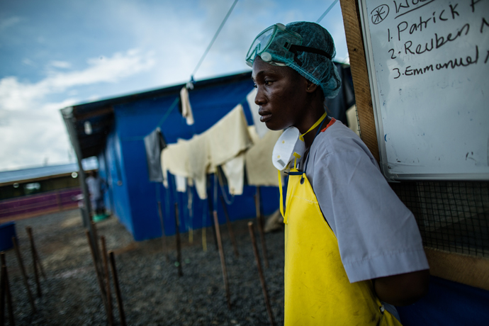 In the war against Ebola, health care workers on the front lines need more than personal protective equipment and training to keep safe. / Morgana Wingard, USAID