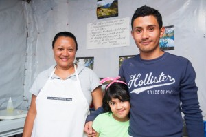 Chuy with his mother and sister in their kitchen, where his burger business is based. / David Snyder, Creative Associates International