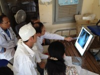 X-ray technicians in Cambodia are trained to identify characteristics that define TB. / Seak Kunrath