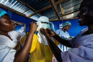 A Liberian nurse prepares to go inside an Ebola patient ward to draw blood from confirmed patients for testing in Bong County last October. / Morgana Wingard, USAID