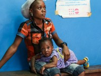 A little girl prepares to get her final round of adolescent shots at the Star of the Sea clinic in Monrovia, Liberia. / Adam Parr, USAID