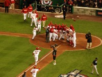 Ryan Zimmerman, third baseman for the Washington Nationals, on his way to homeplate to be mobbed by his ecstatic teammates after hitting a game-winning home run against the Atlanta Braves on opening night at the inaugural game played at Nationals Park in Washington, D.C. / Kevin Harber, CC