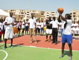 Astou Ndiaye shows off her ball-handling skills at last year's launch of Live, Learn, and Play, a partnership between USAID and the National Basketball Association. / Zack Taylor, USAID