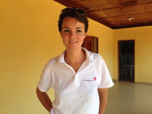 Anne-Flore Hivet leads social mobilization efforts for French Red Cross in Forécariah, Guinea and acts as a chief tour guide inside its Ebola treatment facility. / Carol Han, USAID/OFDA