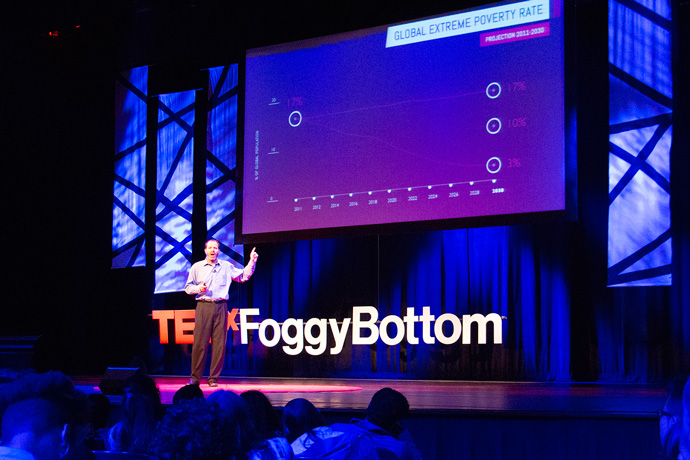 Alex Thier, USAID's Assistant to the Administrator for Policy, Planning and Learning, on the main stage at TEDx Foggy Bottom 2015. / Gregg Rapaport, USAID