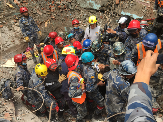 On April 30, the USAID DART's urban search-and-rescue teams helped pull 15-year-old Pemba Tamang from the rubble, five days after the Nepal earthquake. / Chief Chris Schaff, Fairfax County Fire and Rescue