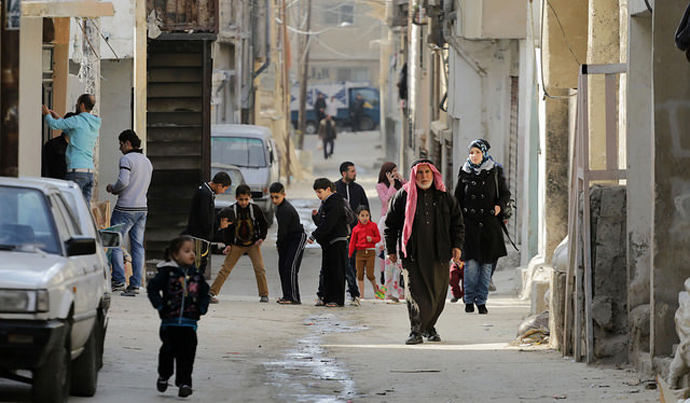 Children play in the streets of the Hittein Refugee Camp in Zarqa, Jordan. / USAID Jordan