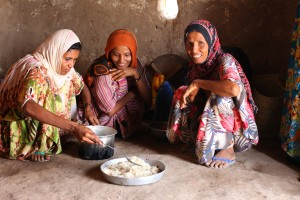 As USAID's senior coordinator for gender equality and women's empowerment, Susan advocates for the inclusion of issues affecting women and families into development work. A women and her children prepare food for dinner in the Aldoosh Village in Yemen with food provided through a USAID program. / Mercy Corps