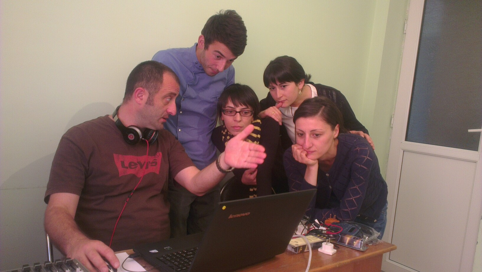 Journalists for SK News gather around a laptop to learn about online TV broadcasting during a New Media Initiative training Akhaltsikhe, Georgia. / Photo by Nino Narimanashvili