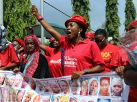 Members of the Bring Back Our Girls group campaigning for the release of the Chibok schoolgirls kidnapped by Boko Haram Islamists march to meet with the Nigerian president in Abuja, on July 8. / Philip Ojisua, AFP