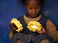 In Addis Ababa, Ethiopia, a schoolgirl is introduced to Little Sun – her first solar-powered light – and the concept that she can hold power in the palm of her hand. / Merklit Mersha