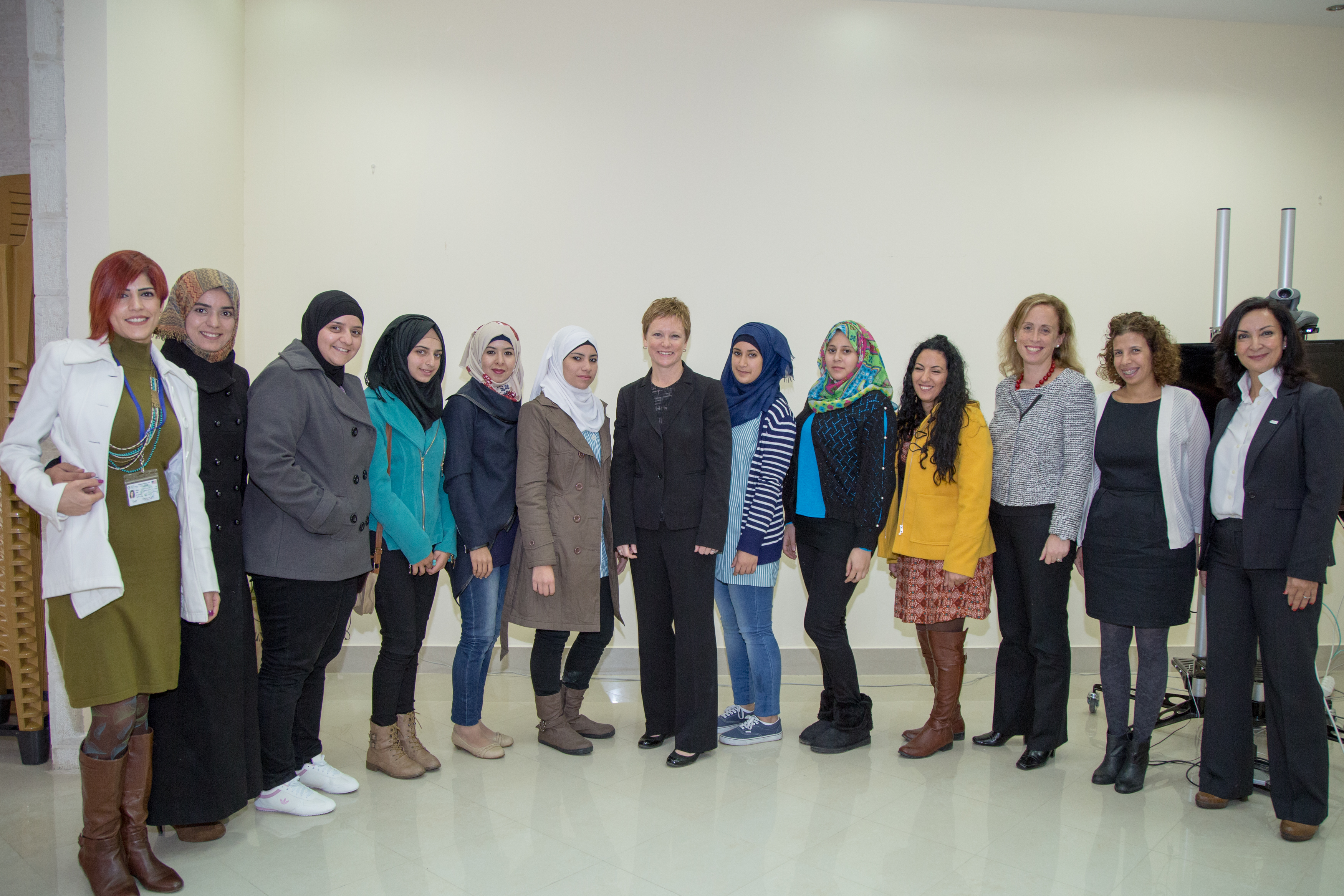 Susan takes a photo with  participants of a youth council roundtable in West Bank, Gaza. /  Global Communities