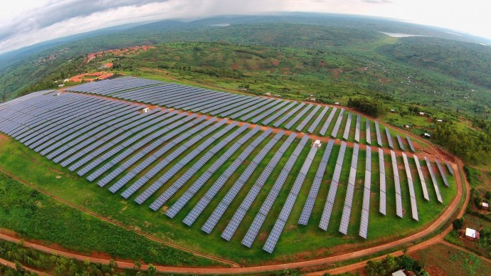 This solar field at the Agahozo Shalom Youth Village in the hills east of Kigali, Rwanda is the first utility-scale, grid-connected, commercial solar field in East Africa. The 8.5 MW, $23 million project increased Rwanda's generation capacity by 6%. / Photo by Sameer Halai, SunFunder