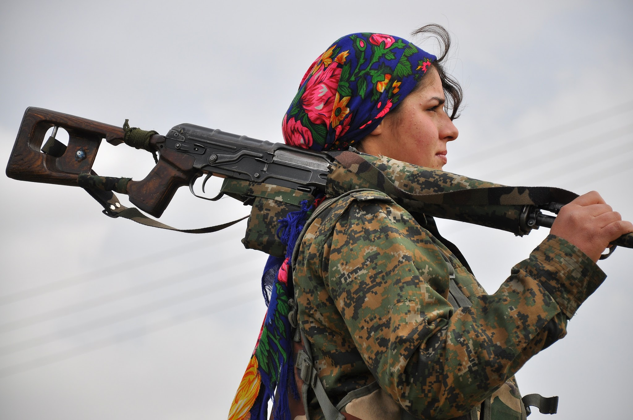 A Kurdish female fighter of the Women's Protection Units looks on at a training camp in al-Qahtaniyah, near the Syrian-Turkish border on Feb. 13. Syrian Kurdish forces have been fighting advances by the Islamic State jihadist group. / Delil Souleiman, AFP