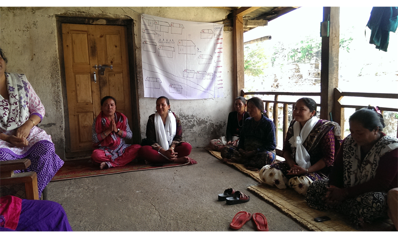 A village committee in Nepal discusses safe migration to counter human trafficking. / Marina Colby, USAID