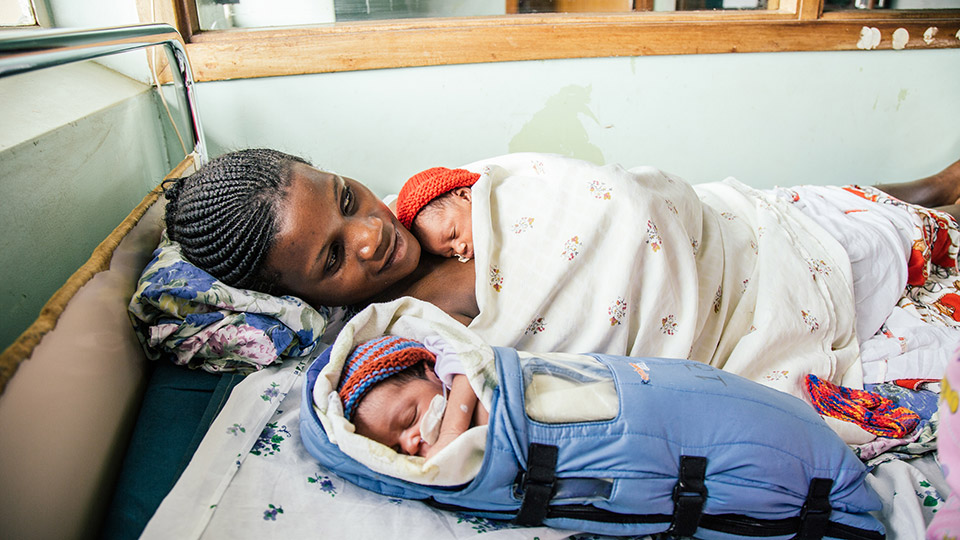Mom and baby are doing fine because mom was taught how to perform Kangaroo Mother Care to keep her premature newborn warm. / Molly Ronan, Embrace Global
