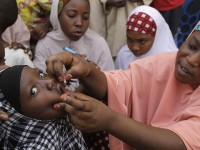 A health worker administers a polio vaccine to a girl in Nigeria. / Courtesy of TSCHIP