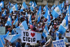 "People hold national flags and a sign reading ""I love CICIG (International Commission Against Impunity in Guatemala)"" as they take part in a Aug. 22 demonstration in Guatemala City demanding President Otto Perez's resignation. / Johan Ordonez, AFP"