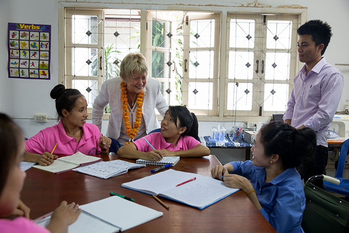 USAID Senior International Education Advisor Christie Vilsack greets young women in an English class at the Lao Disabled Women's Development Centre in July 2015. / David Lienemann, Official White House Photographer