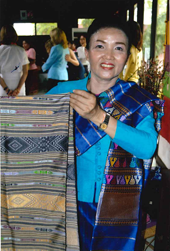 Madam Chanhpheng Sivila shows off a scarf made by young women at the Lao Disabled Women's Development Centre. / David Lienemann, Official White House Photographer