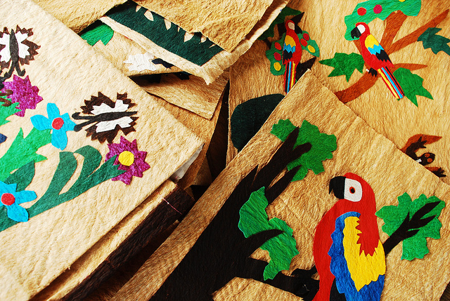 Women in an indigenous community in the Mosquitia region of Honduras make handicrafts depicting macaws and other forest creatures using wood chips left over from processing certified sustainable mahogany. Income from handicrafts and timber help people value and conserve forest habitat to rather than clearing it for agriculture. / Charlie Watson, Rainforest Alliance