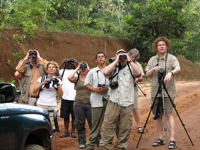 "Their enthusiasm and tenaciousness helps ""birders"" pave the way for ecotourism in remote areas lacking infrastructure and amenities. USAID support this group of birding journalists and tour operators get familiar with Guyana's Iwokrama forest. / Martina Miller"