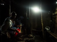 Nearly two-thirds of people in Sub-Saharan Africa lack access to power, but investments in technology like solar-powered home kits are allowing people including Lucy Sakuda of Olorien, Kenya to access power for the first time. / Morgana Wingard, USAID