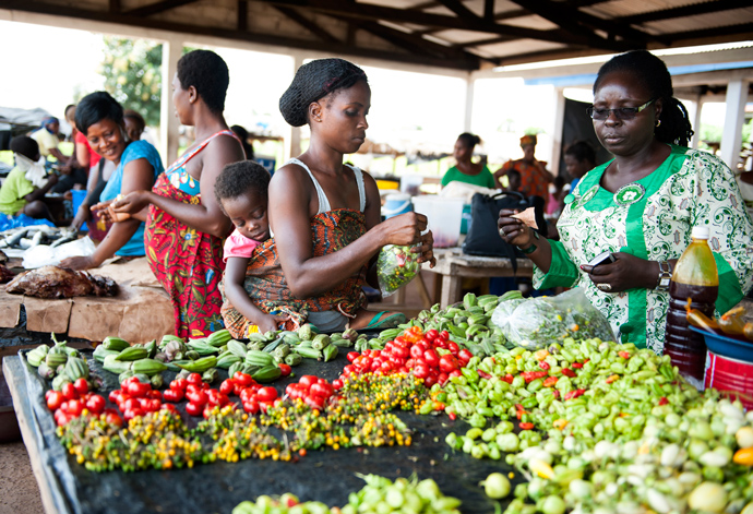 Women sell their goods at a market in Duékoué, Côte d'Ivoire, on Sept. 30. USAID's Office of Transition Initiatives helped strengthen dialogue and positive interaction between the market women after tensions between their different ethnic communities led them to minimally engage with each other. Read more here. / Kendra Helmer, USAID