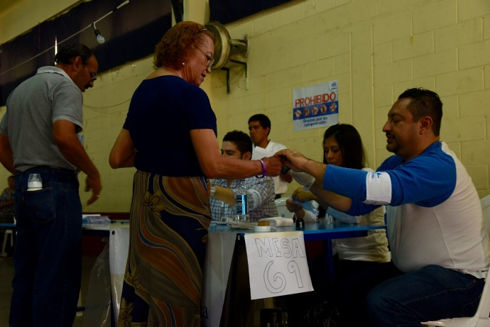 A transgender woman votes in Guatemala's 2015 elections. / Shannon Schissler, USAID