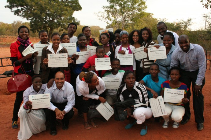 Emily with two employees of Project Concern International (PCI) and her youth group members, celebrating the youths' graduation from PCI's Entrepreneurial and Business Skills Training in Botswana. / Project Concern International