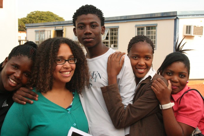 Emily with four youth group members in Botswana. / Project Concern International