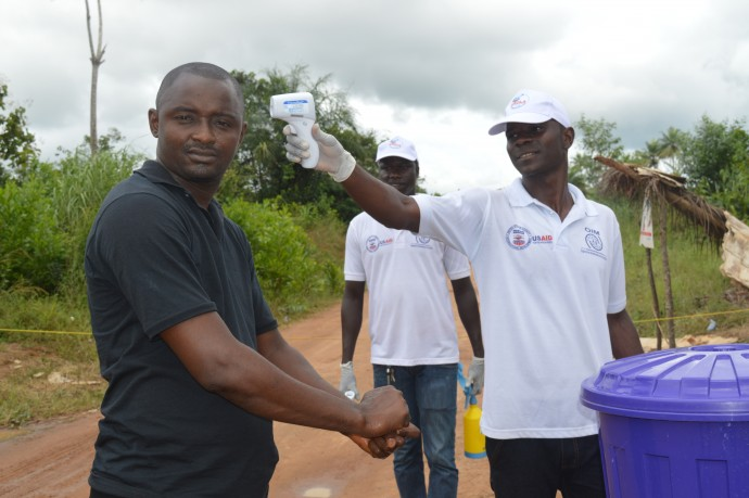 Practices like handwashing and temperature checks at international borders are critical for the continued fight against Ebola. Border management has been a key part of USAID's response to the outbreak. / International Organization for Migration