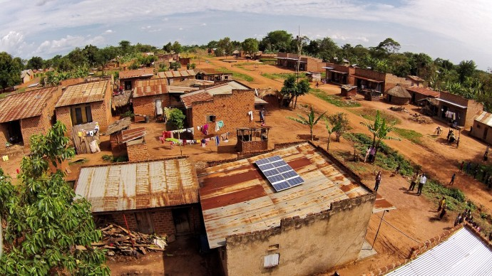 This 500-watt solar system, installed by SolarNow and financed by Power Africa partner SunFunder, provides clean power for a home, a public broadcasting system, a barbershop and a video hall in a rural village in Uganda. / Sameer Halai, SunFunder