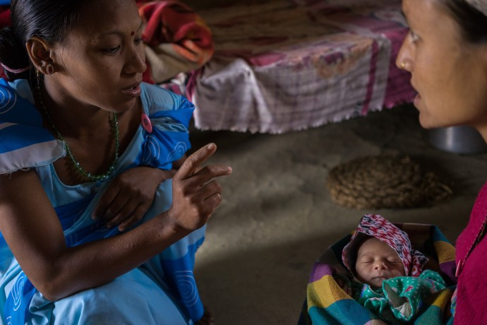 A female community health volunteer counsels a mother from Nepal about caring for her baby after birth. Setting children on a path to healthy physical growth and cognitive development is a priority of the All Children Thriving partnership. / Thomas Cristofoletti, USAID