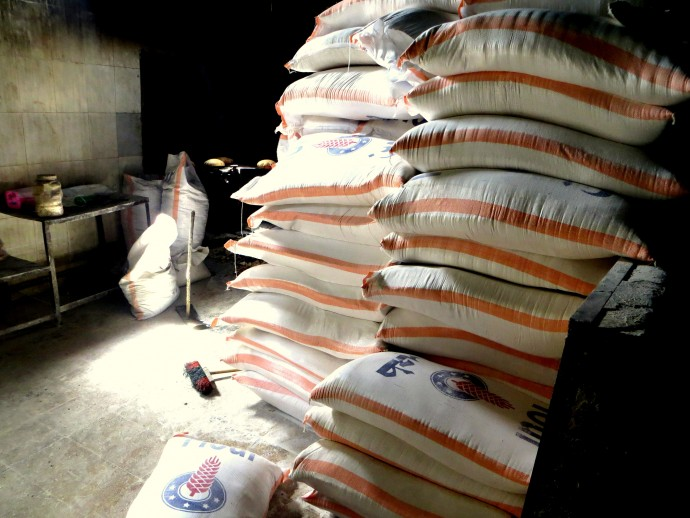 Bags of wheat flour inside a storage room at a Syrian bakery wait to be turned into bread. Bakeries such as this one are vital to providing food to Syrians in need.