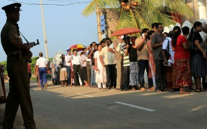 Sri Lankans line up to cast their vote during the country's presidential election in January 2015. / USAID