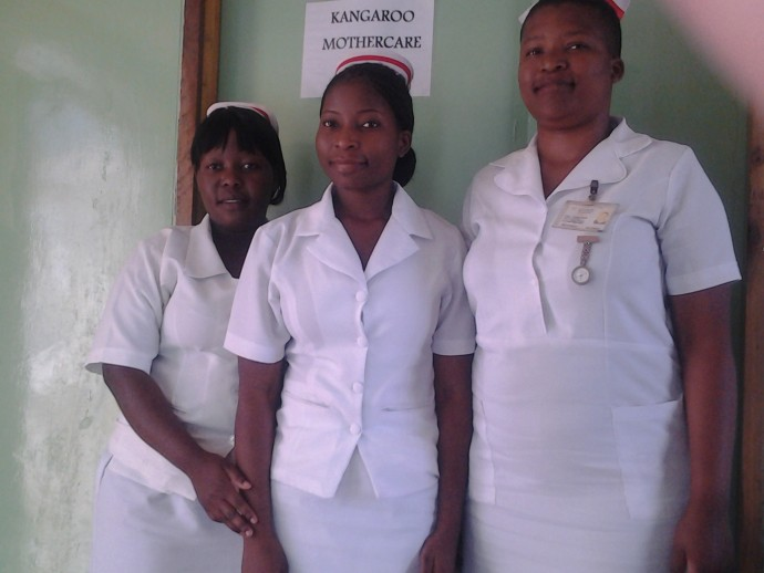Memory Mponda (right), Priscilla Ziyaye and Pacharo Kumwenda, USAID-supported students training to become nurse-midwives, stand outside the Kangaroo Mother Care ward at the Chonde Health Center. / Grace Soko, Christian Health Association of Malawi