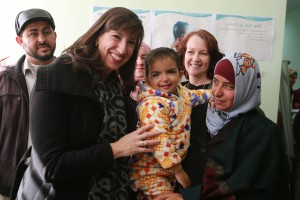 USAID Assistant Administrator Paige Alexander meets a Syrian family living in Tafileh, Jordan. / Mohammed Maghayda, USAID