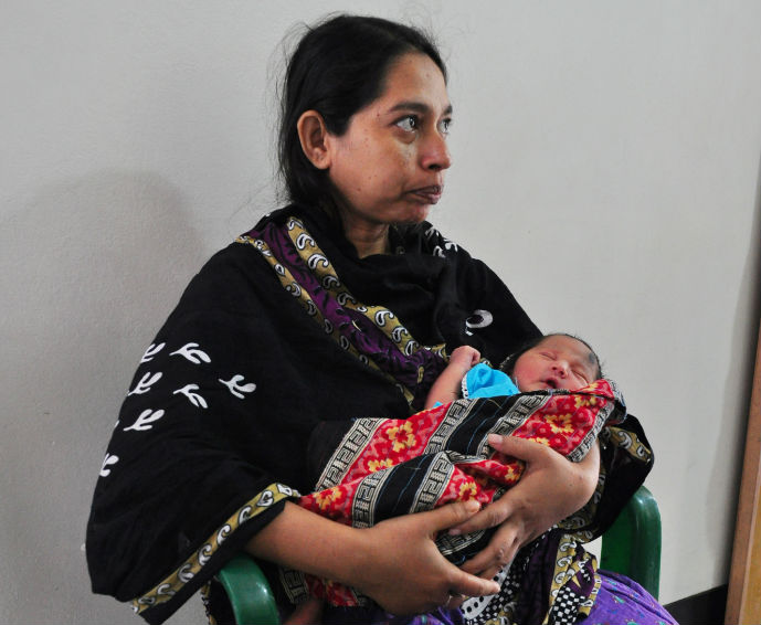 Fatima holds her 2-day-old baby, safely and successfully delivered at the USAID-funded Smiling Sun Clinic in Tongi, Bangladesh. / Amy Fowler, USAID