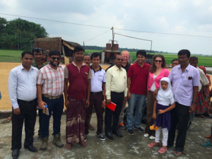 Local bank and USAID staff with Somer Ali near his rice milling operation. / USAID Bangladesh