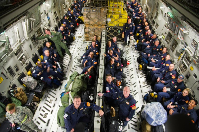 A medium sized urban search and rescue team made up of 57 members of the Los Angeles County Fire Department and 60,000 pounds of equipment, activated by USAID, board a C-17 Globemaster III at March Air Reserve Base, April 27, 2015. The team is in response to the magnitude 7.8 earthquake and subsequent aftershocks which struck near the city of Kathmandu, Nepal on April 25. The C-17 is assigned to the 337th Airlift Wing, Charleston Air Force Base, S.C. (US Air Force Photos by Master Sgt. Roy A. Santana/Released)